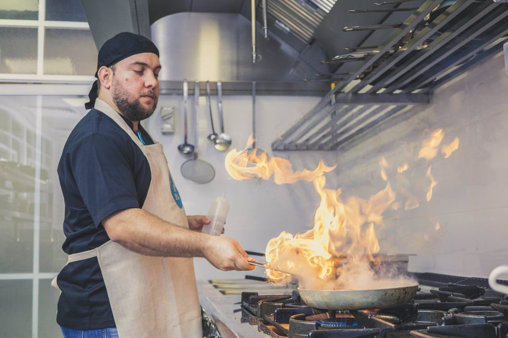 Image of a Chef with Fire Pan - Perfect Recipe of a Successful Restaurant Cover